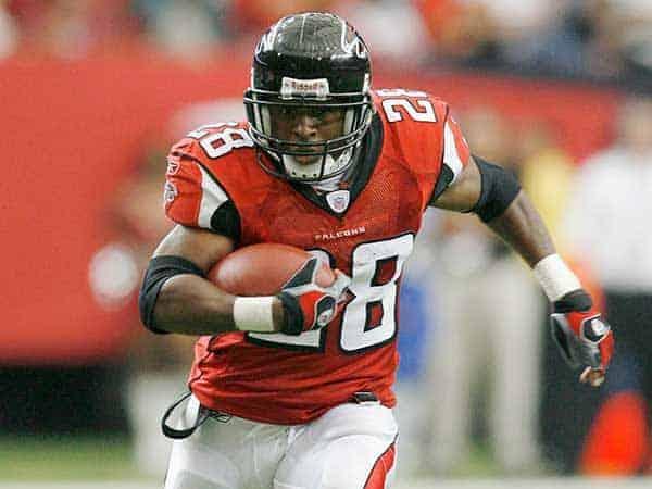 Atlanta Falcons running back Warrick Dunn is a fast runner football player