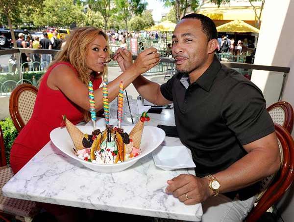 Terrell Fletcher and his wife Sheree Fletcher celebrating their sixth wedding anniversary