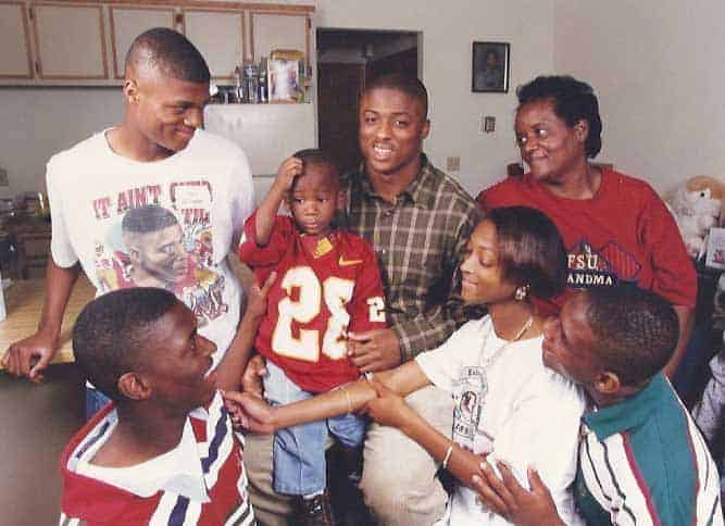 Happy family picture of Warrick Dunn with his siblings