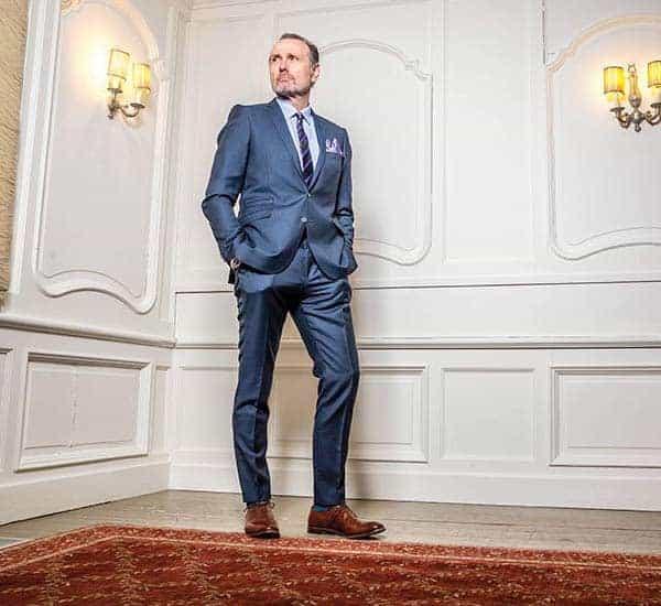 Tallest Michael Bonacini posing in blue suit