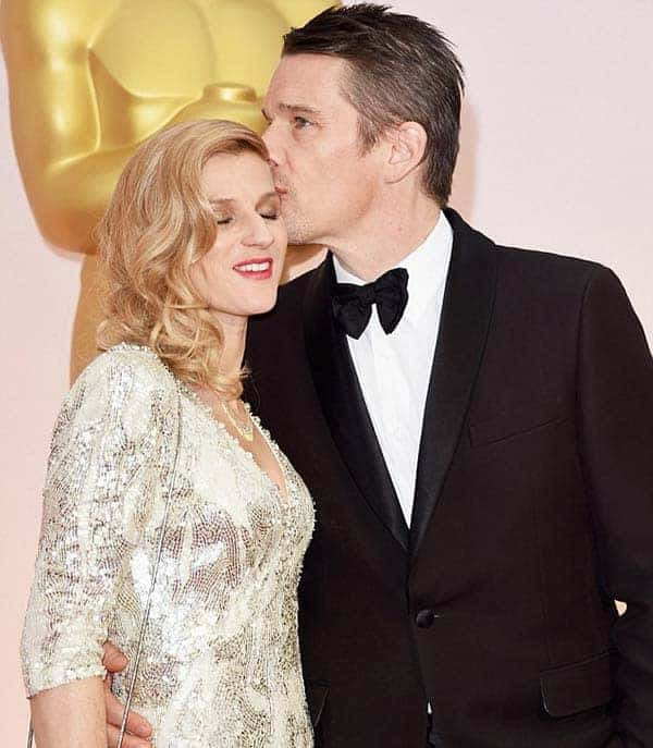 Ethan Hawke kissing his wife Ryan