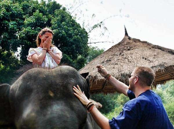 Josh Gates Is Assisting Hallie Gnatovich While Riding Elephant