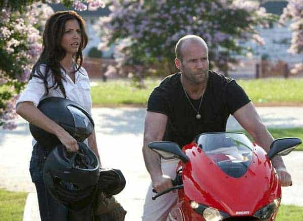 Charisma Carpenter and Jason Statham in The Expendables movie scene