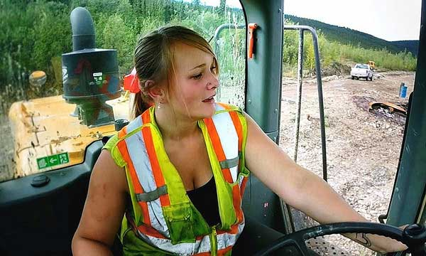 Monica Beets, daughter of Tony Beets and Minnie Beets riding heavy trucks