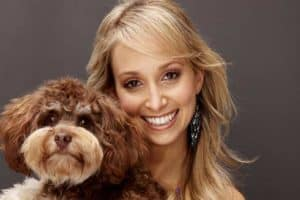 Lisa Chimes posing with adorable dog