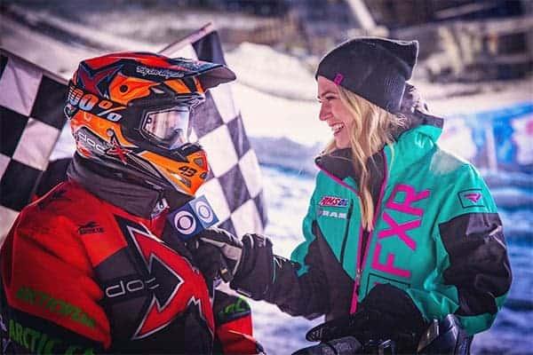 Katie Osborne taking interview with racer