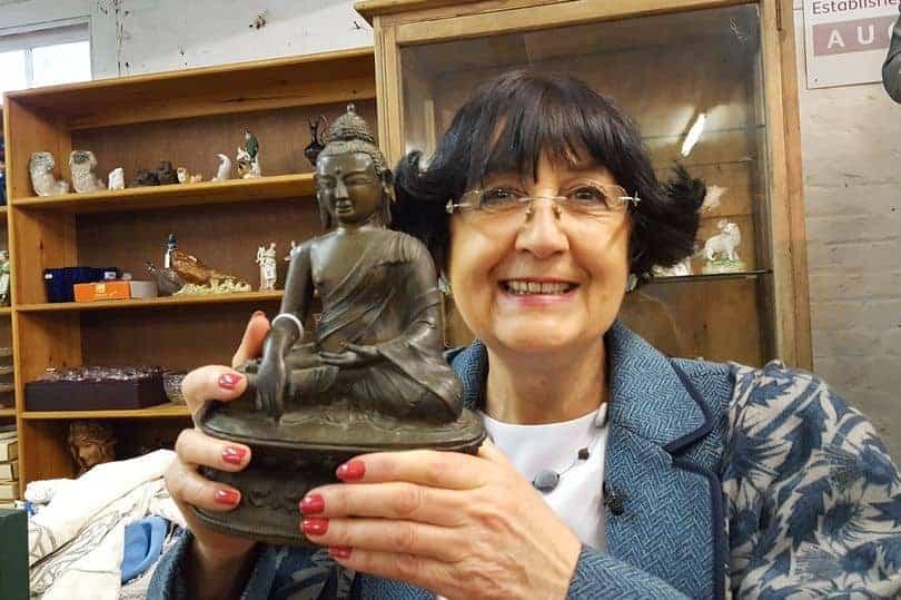 Anita Manning with Buddha statue