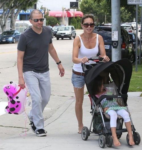 Lisa Joyner with her husband Jon and their adopted daughter