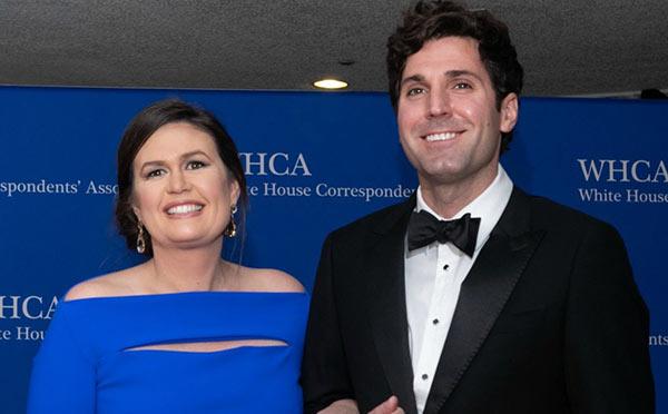 Iimage of Sarah Huckabee Sanders with her husband Bryan Chatfield Sanders