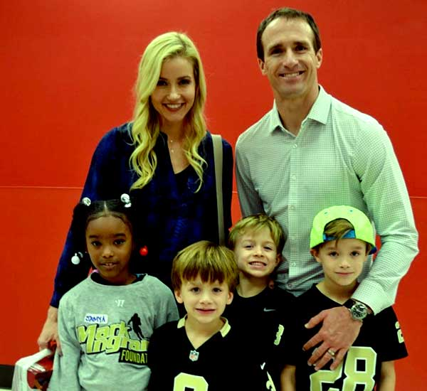 Brittany Brees with her husband Drew Brees and their kids
