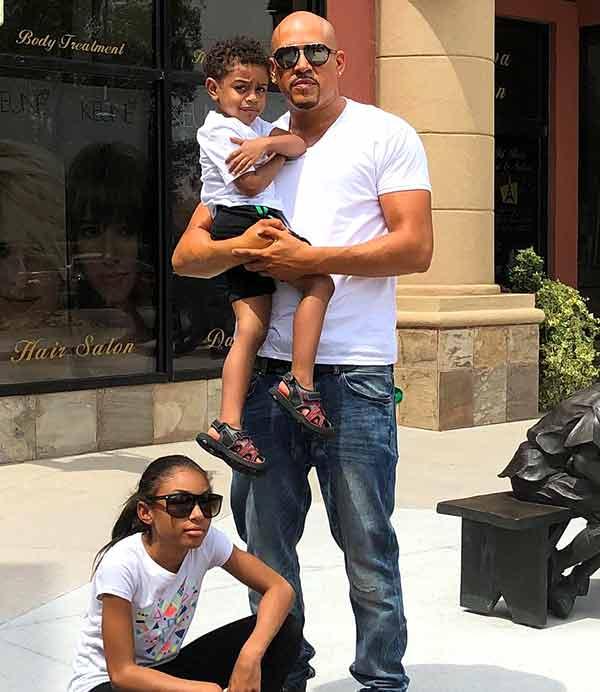 Image of Cisco Rosado with his son Cisco Rosado Jr and daughter Tianna