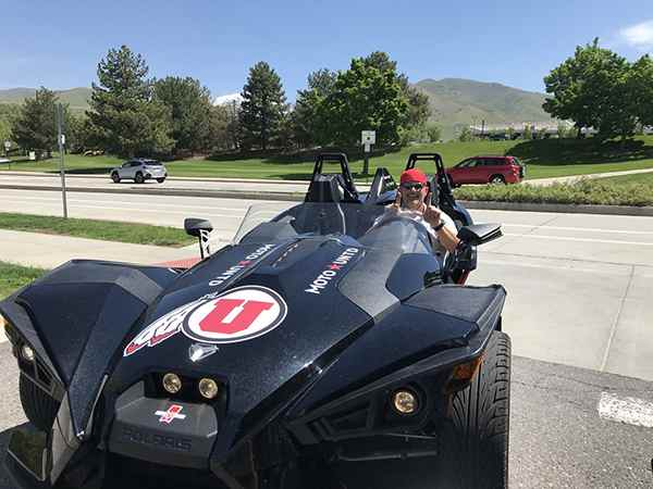 Image of Kyle Whittingham with his car